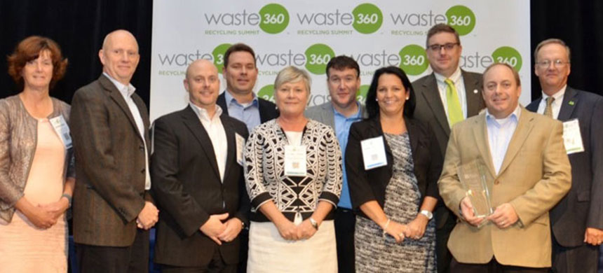 Maria Frizzell (CEO of Schaefer Waste Technology Division) and Chad Jenkins (CEO of SeedSpark) along with members of the NWRA.